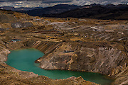 The turquoise tone of the groundwater pool is due to high concentration of copper, a byproduct of gold mining in Yanacocha, Peru, Friday, October 16, 2015. (Hilaea Media/ Dado Galdieri)