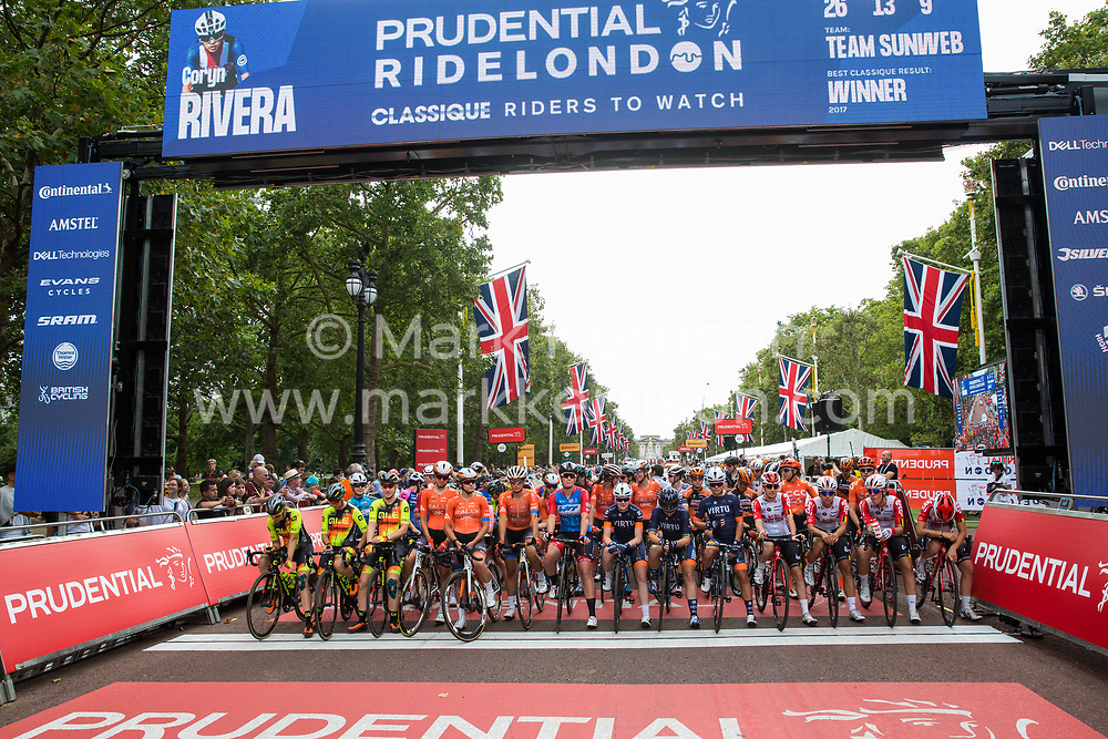 London, UK. 3 August, 2019. Elite riders from sixteen of the world's top professional female cycling teams, including last year's winner Kirsten Wild (c) of WNT-Rotor Pro Cycling Team, wait on the start line for the Prudential RideLondon Classique. The Classique, which is the richest one-day women's race in the world, covers 20 laps of a tight circuit of 3.4 kilometres around St James's Park and Constitution Hill.