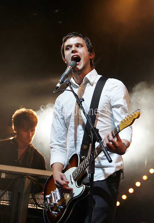 Harry McVeigh of White Lies performs live on the NME/Radio 1 stage during day two of the Reading Festival on August 29, 2009 in Reading, England.  (Photo by Simone Joyner)