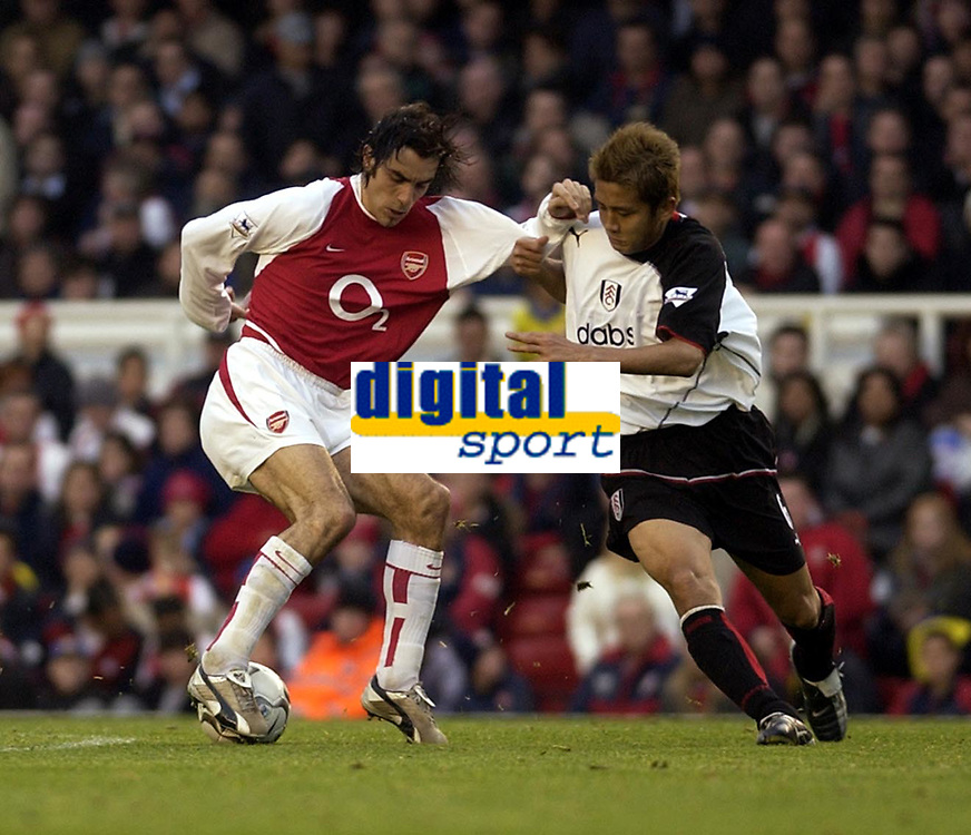 Picture: Henry Browne.<br />Date: 30/11/2003.<br />Arsenal v Fulham  FA Barclaycard Premiership.<br />Robert Pires battles with Junichi Inamoto of Fulham