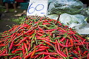 "26 SEPTEMBER 2012 - BANGKOK, THAILAND:  Hot chilli peppers for sale in Khlong Toey Market in Bangkok. Khlong Toey (also called Khlong Toei) Market is one of the largest ""wet markets"" in Thailand. The market is located in the midst of one of Bangkok's largest slum areas and close to the city's original deep water port. Thousands of people live in the neighboring slum area. Thousands more shop in the sprawling market for fresh fruits and vegetables as well meat, fish and poultry.    PHOTO BY JACK KURTZ"