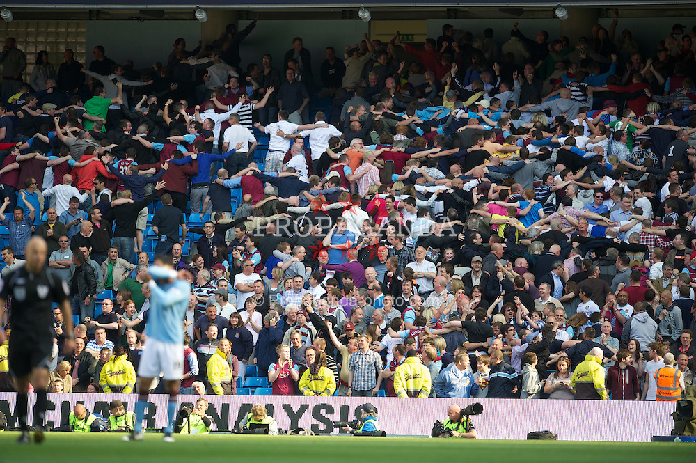 MANCHESTER, ENGLAND - Sunday, May 1, 2011: West Ham United's fans celebrate their goal by mimicing Manchester City fans' copy of Poznan's celebration during the Premiership match at the City of Manchester Stadium. (Photo by David Rawcliffe/Propaganda)