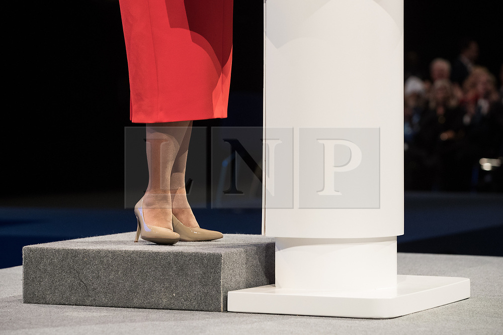 © Licensed to London News Pictures  . 03/10/2017 . Manchester , UK . International development secretary PRITI PATEL jokes during her speech about having to stand on a platform to deliver her keynote speech , on day three of the Conservative Party Conference at the Manchester Central Convention Centre . Photo credit : Joel Goodman/LNP