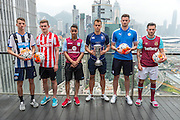 HKFC Citi Soccer Sevens Press conference at the Excelsior Hotel rooftop Causeway Bay. HKFC Gary Gheczy holds the cup they will play for.Players L to R- Newcastle United Dan Barlaser,Stoke City Lewis Banks,Aston Villa Khalid Abdo,HKFC Gary Gheczy,Leicester City Elliott Moore and West Ham Lewis Page