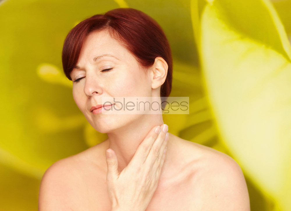 Woman with Hands on Neck