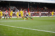 Brentford midfielder John Swift comes close to bagging himself a goal, but for Rotherham United defender (and former Brighton player) Joe Mattock's brilliant tackle during the Sky Bet Championship match between Brentford and Rotherham United at Griffin Park, London, England on 17 October 2015. Photo by Andy Walter.