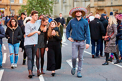 © Licensed to London News Pictures. 01/05/2018. OXFORD, UK.  Thousands of students, residents and visitors gather in Oxford on May Morning to hear the Magdalen College Choir perform the Hymnus Eucharisticus at 6am. The traditional celebration has been marred in previous years by injuries caused by people jumping from the bridge and crowd congestion leading to a large security presence.  Photo credit: Cliff Hide/LNP