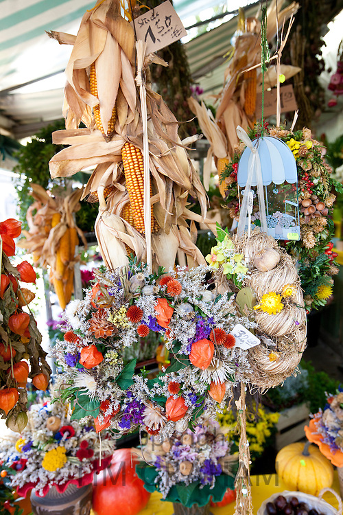 Dried flowers at traditional outdoor Christmas market at Viktualienmarkt  in Munich, Bavaria, Germany