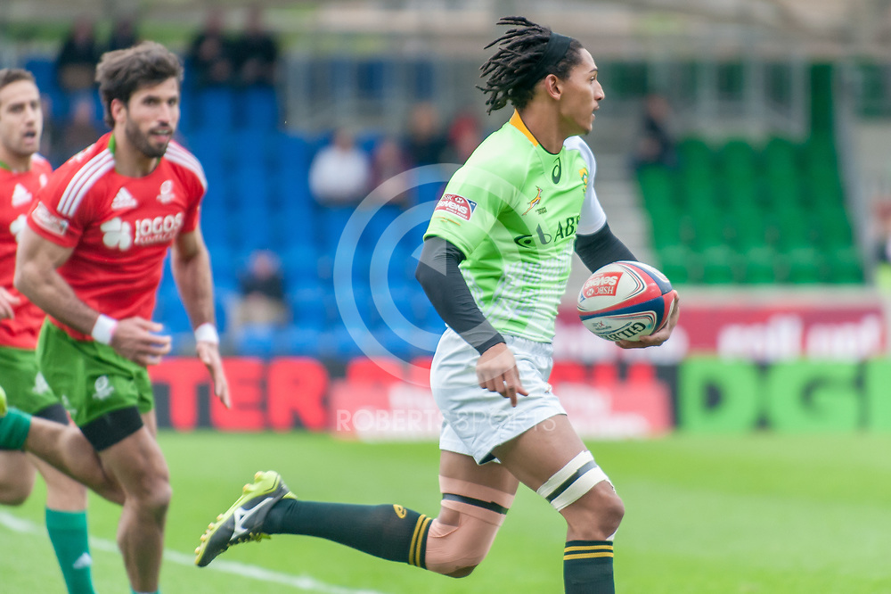 South Africa's Justin Geduld races away to score against Portugal. Action from the IRB Emirates Airline Glasgow 7s at Scotstoun in Glasgow. 3 May 2014. (c) Paul J Roberts / Sportpix.org.uk