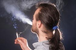 Man smoking marijuana,