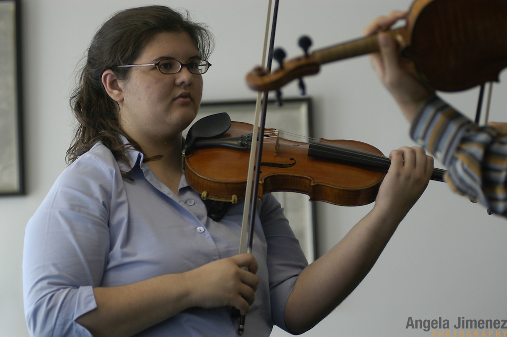 "Violinist Elizabeth ""Libby"" Fayette of Long Island, New York, 17, left, gets adjustments from teacher Kyu-Young Kim (a substitute instructor who is not her regular teacher) during her weekly private lesson in the Pre-College Division program at The Juilliard School, located at West 65th Street and Broadway in New York City, on Saturday, September 24, 2005. Students audition for spots in the prestigious program, in which they can study until they graduate from high school."
