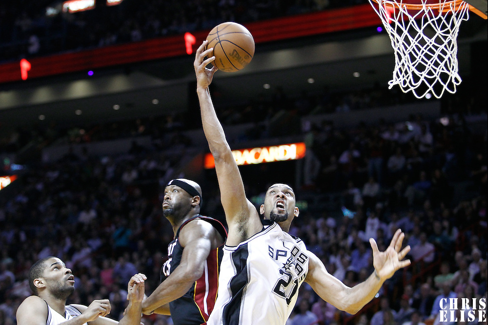 14 March 2011: San Antonio Spurs center Tim Duncan (21) grabs a rebound during the Miami Heat 110-80 victory over the San Antonio Spurs at the AmericanAirlines Arena, Miami, Florida, USA.