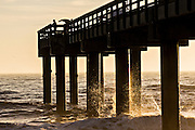 Sunrise over a fishing pier on St Augustine Beach, Florida.