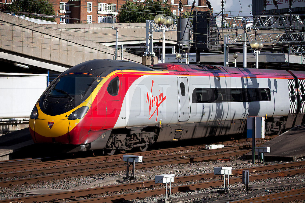 © Licensed to London News Pictures. 04/10/2012. LONDON, UK. A Virgin train is seen leaving Euston Station in London.  Photo credit: Matt Cetti-Roberts/LNP