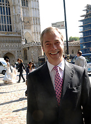 A newly married bride, background left, walks past The UKIP leader Nigel Farage outside London's Central Hall after his speech on party policies and the European Union, Central Hall, Westminster, London, United Kingdom. Friday, 20th September 2013. Picture by Max Nash / i-Images