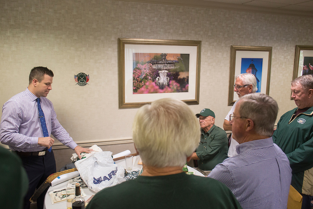 OU hockey head coach Sean Hogan speaks with 1960s hockey alumni during their reunion weekend at the OU Inn on October 1, 2016.