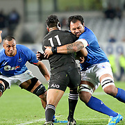All Blacks Julian Savea is crunched by the Manu Samoa defense in the second half.  The New Zealand All Blacks defeated Manu Samoa 15's 83-0 at Eden Park, Auckland, New Zealand.  Photo by Barry Markowitz, 6/16/17