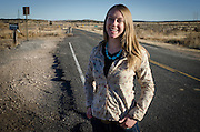 Writer and photo assistant, Rachel Shockley, stands for a portrait on an abondoned section of historic Route 66, which runs parallel to I-40 accross the State of New Mexico.