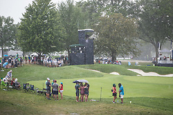 August 10, 2018 - Town And Country, Missouri, U.S - Fans hold their positions at the 9th green despite heavy rainfall waiting to see if the round will continue during round two of the 100th PGA Championship on Friday, August 10, 2018, held at Bellerive Country Club in Town and Country, MO (Photo credit Richard Ulreich / ZUMA Press) (Credit Image: © Richard Ulreich via ZUMA Wire)