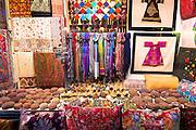 Turkish scarves cushions and kufi Muslim skullcap or taqiyah (tagiya) in Arasta Bazaar, Sultanahmet, Istanbul, Turkey