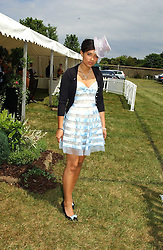 DELILAH KHOMO  at Ladies Day at Epsom Racecourse, Surrey during the Derby Festival on 3rd June 2005.<br /><br />NON EXCLUSIVE - WORLD RIGHTS