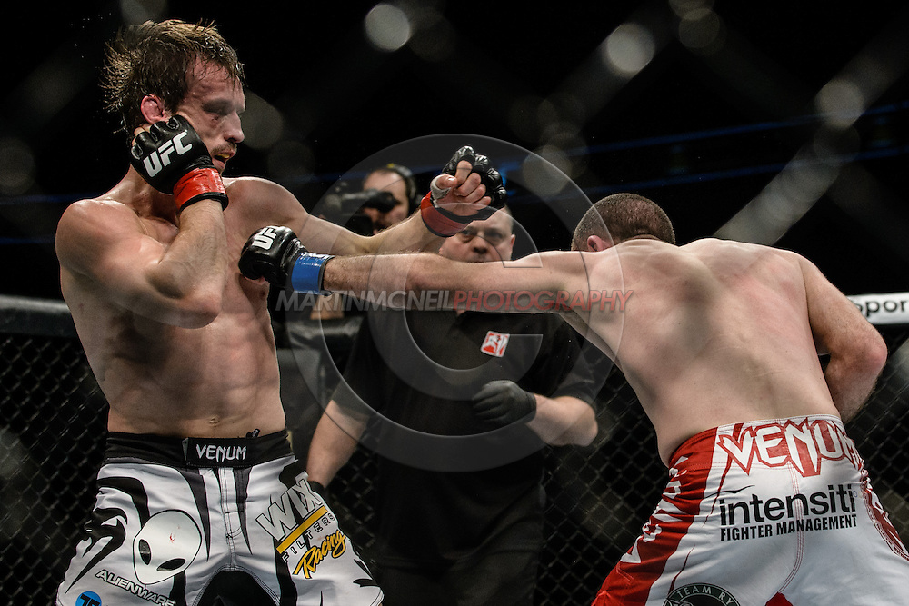 "LONDON, ENGLAND, MARCH 8, 2014: Brad Pickett Neil Seery during ""UFC Fight Night: Gustafsson vs. Manuwa"" inside the O2 Arena in Greenwich, London on Saturday, March 8, 2014 (© Martin McNeil)"