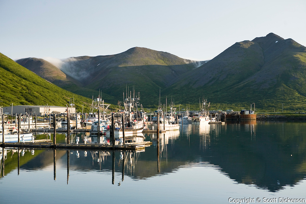 Sunrise on the commercial fishing boats in the King Cove harbor, King Cove, Alaska Peninsula, Alaska.