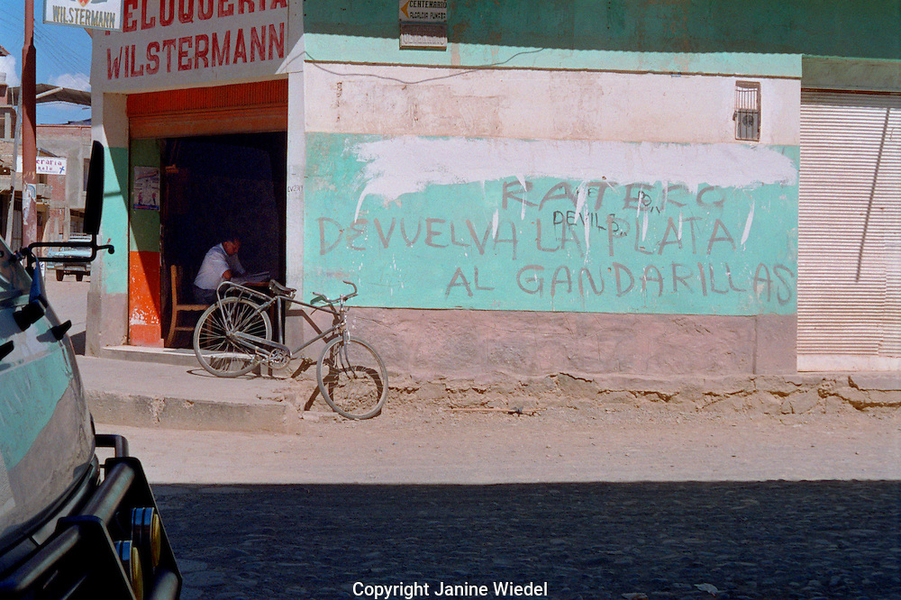 Small town in Guatemala with political grafitti  saying Robbers return your silver to the miners.
