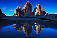 Mountain impression Tre Cime di Lavareddo mirrored in pond - Europe, Italy, South Tyrol, Sexten Dolomites, Tre Cime - July 2009 - Mission Dolomites Tre Cime