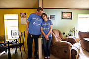 NORTH FREEDOM — October 6, 2014: SaDonna Oakley, right, stands with her husband, Joe, in their North Freedom trailer park home. Oakley was diagnosed with Stage IV colon cancer in May 2014 and went into surgery early morning on Tuesday, October 7 at St Mary's Hospital in Madison.<br />