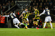 Burton Albion forward Lucas Akins and Millwall FC midfielder Ed Upson battle it out during the Sky Bet League 1 match between Burton Albion and Millwall at the Pirelli Stadium, Burton upon Trent, England on 1 December 2015. Photo by Aaron Lupton.