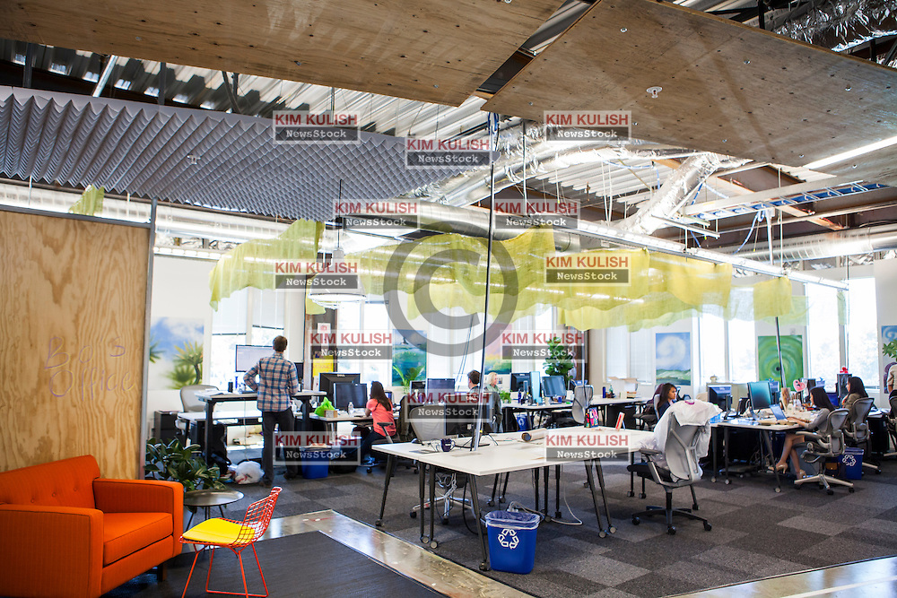Scenes of daily work and life at Facebook', Inc. USA Headquarters in Menlo Park, California.  A view of the unfinished looking workspaces at Facebook.