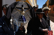 Potosi, Bolivia.<br /> Sunday in Potosi old town a group of catholic worshippers carry a crucifix before them.