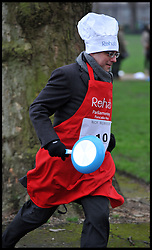 BBC Nick Robinson takes part in the MP's and Lords race against political Journalist in the Rehab Parliamentary Pancake Shrove Tuesday race a charity event which sees MPs and Lords joined by media types in a race to the finish. Victoria Tower Gardens, Westminster, Tuesday February 12, 2013. Photo By Andrew Parsons / i-Images