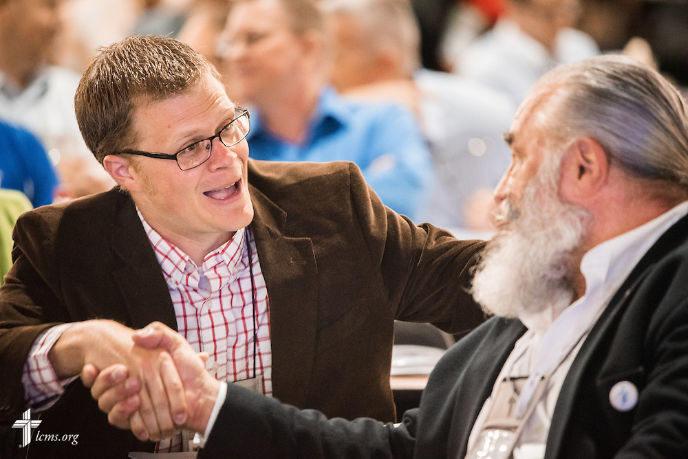 The Rev. Peter Jurchen, associate pastor of Immanuel Lutheran Church in Columbus, Neb., greets Joseph Zeneski of North Oxford, Mass., during a short break at the 66th Regular Convention of The Lutheran Church–Missouri Synod on Sunday, July 9, 2016, at the Wisconsin Center in Milwaukee. LCMS/Frank Kohn