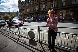 First Minister of Scotland and leader of the SNP Nicola Sturgeon, out on the election trail to make sure people are out voting today, May 7, 2015 in Glasgow, Scotland. At Craigie Street Pollokshields polling station.