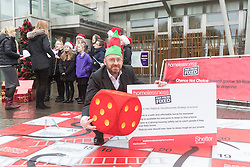 """Campaigners from Shelter Scotland raise awareness of their campaign """"Homelessness - Far From Fixed"""" outside the Scottish Parliament in Edinburgh. They are joined by carol singers from Corstorphine Primary School, a Christmas tree and a giant snakes and ladders board game - Chance Not Choice - which illustrates how life chances affect people's ability to keep a roof over their head.<br /> <br /> Pictured: Patrick Harvie (Scottish Green Party)"""