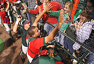 TinCaps catcher Robert Lara (5) celebrates with fans after their win over the Bees in game three of the Midwest League Championship at Community Field in Burlington, Iowa on September 17, 2009.
