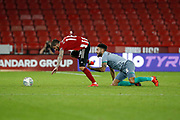 Derrick Williams of Blackburn Rovers uses his hands to trip and foul Kieron Freeman of Sheffield United during the EFL Cup match between Sheffield United and Blackburn Rovers at Bramall Lane, Sheffield, England on 27 August 2019.