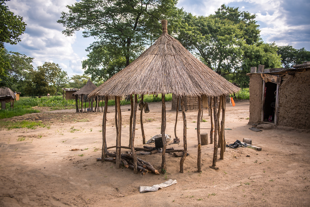 Thatched-roof hut found in village provides cover and shade,  Livingstone, Zambia
