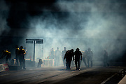April 22-24, 2016: NHRA 4 Wide Nationals: NHRA crew clean the track after a burnout