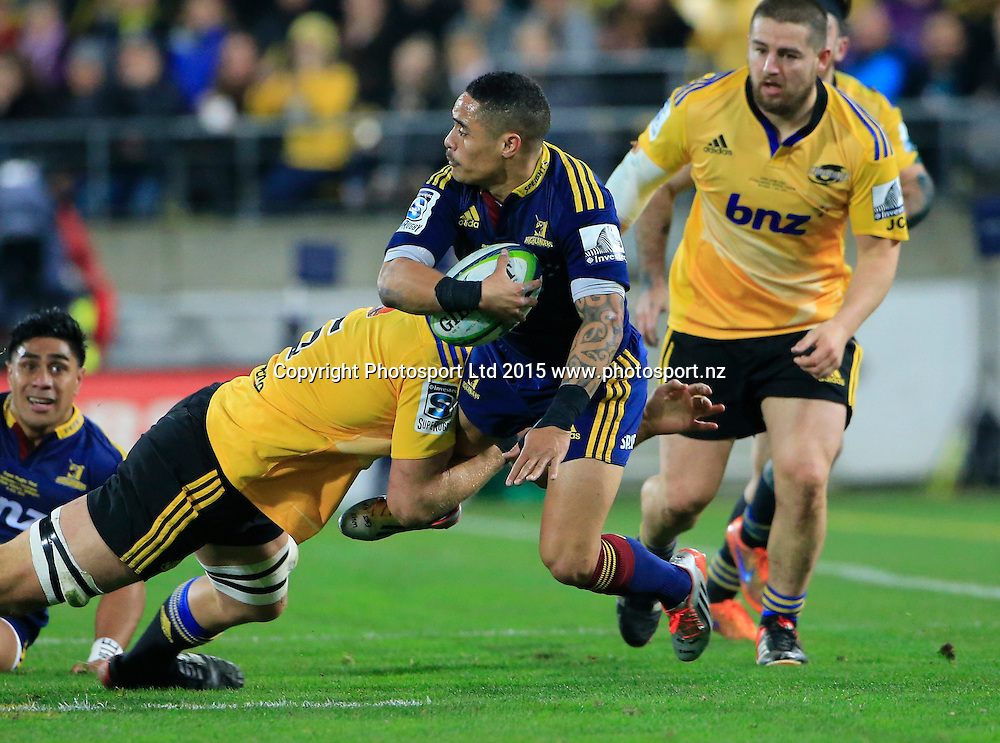 Aaron Smith off loads in the tackle. Super Rugby Final, Hurricanes v Highlanders. Westpac Stadium, Wellington, New Zealand. 4 July 2015. Copyright Photo: John Cowpland / www.photosport.nz