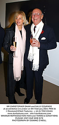 MR CHRISTOPHER SHAW and SALLY COURAGE at an exhibition in London on 9th February 2004.PRM 35