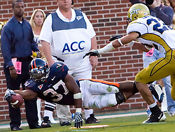 Virginia running back Cedric Peerman (37) dives for a first down near the goal line late in the fourth quarter.  The Virginia Cavaliers defeated the #18 ranked Georgia Tech Yellow Jackets 24-17 in NCAA Division 1 Football at Bobby Dodd Stadium on the campus of Georgia Tech in Atlanta, GA on October 25, 2008.