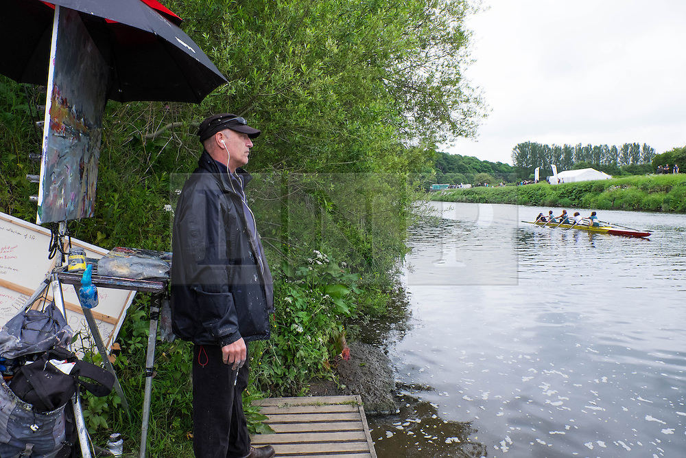 &copy; Licensed to London News Pictures.13/06/15<br /> Durham, England<br /> <br /> An artist turns from his work to watch the rowing during the 182nd Durham Regatta rowing event held on the River Wear. The origins of the regatta date back  to commemorations marking victory at the Battle of Waterloo in 1815. This is the second oldest event of this type in the country and attracts over 2000 competitors from across the country.<br /> <br /> Photo credit : Ian Forsyth/LNP