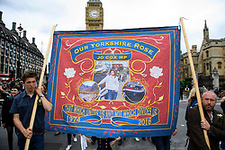 """© Licensed to London News Pictures. 22/06/2016. London, UK. A banner reading """"OUR YORKSHIRE ROSE, JO COX MP"""" outside the Houses of Parliament in London, ahead of a memorial service to mark the life of the Labour MP for Batley and Spen, Jo Cox, who was murdered near her constituency office.  Jo Cox would have turned 42 today. Photo credit: Ben Cawthra/LNP"""