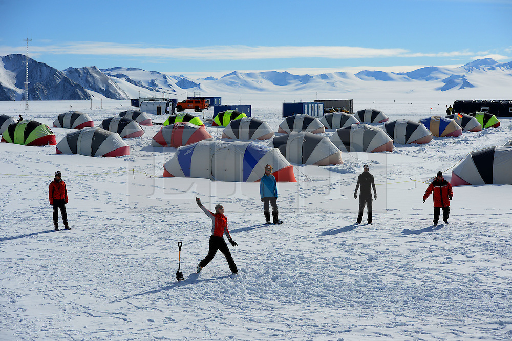 "© Licensed to London News Pictures. Union Glacier, Antarctica. LAUREN JONES from Perth, Australia bowling. Competitors from the Antarctic Ice Marathon play a game of impromptu ""Ashes"" cricket at the Union Glacier camp, Antarctica ahead of the 2013 Antarctic Ice Marathon, which takes place  just a few hundred miles from the South Pole at the foot of the Ellsworth Mountains.. The majority of players were either Australian and English. It was declared a sporting draw. Photo credit: Mike King/LNP"