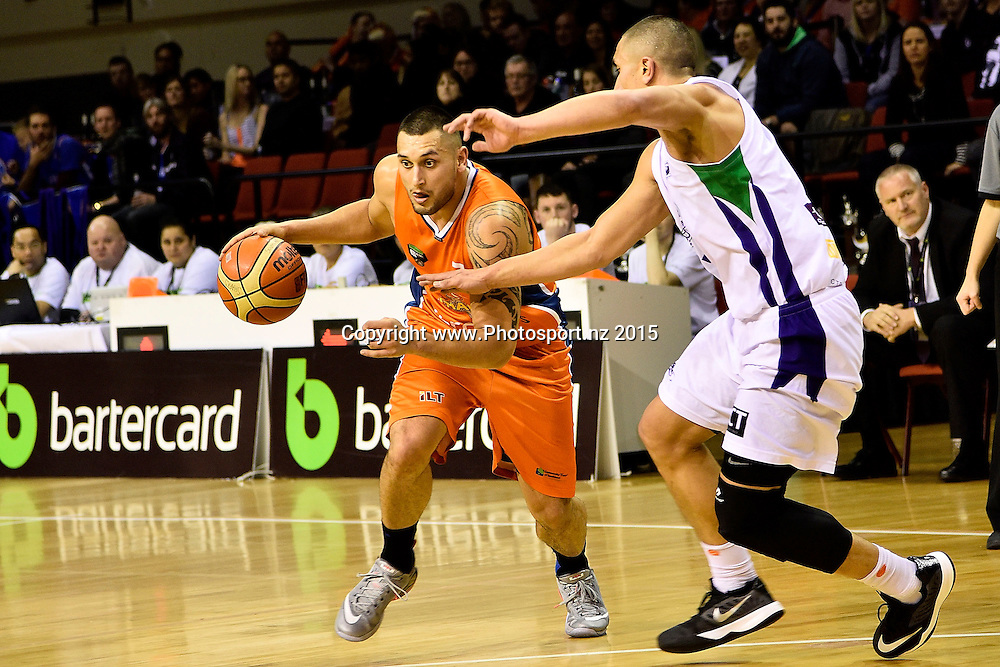 Duane Bailey (L) of the Southland Sharks dribbles the ball with Reuben Te Rangi of the Super City Rangers during the NBL semi final basketball match between Southland and Super City Rangers at the TSB Arena in Wellington on Saturday the 4th of July 2015. Copyright photo by Marty Melville / www.Photosport.nz
