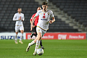 Milton Keynes Dons midfielder Conor McGrandles (18) sprints forward with the ball during the EFL Trophy match between Milton Keynes Dons and Wycombe Wanderers at stadium:mk, Milton Keynes, England on 12 November 2019.