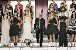 German fashion designer Karl Lagerfeld on the catwalk among models after Chanel Ready-to-Wear Spring-Summer 2006 collection presentation at the 'Grand Palais', in Paris, France, on October 7, 2005. Photo by Nebinger-Orban-Zabulon/ABACAPRESS.COM.